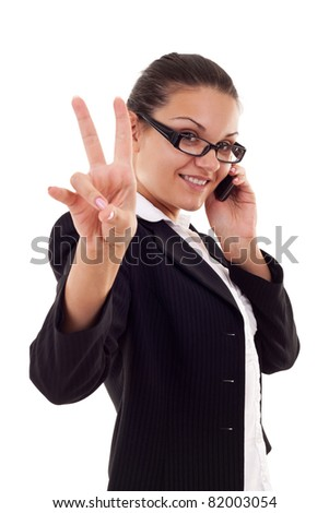 Happy business woman with phone and victory gesture, isolated