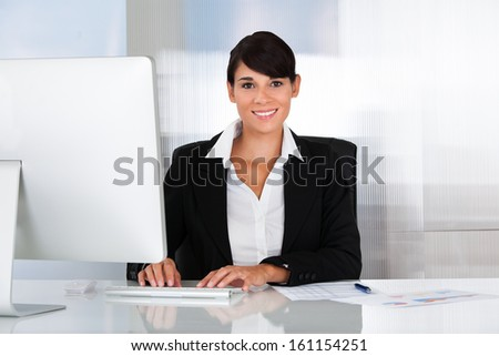 Happy Business Woman Working On Computer In The Office