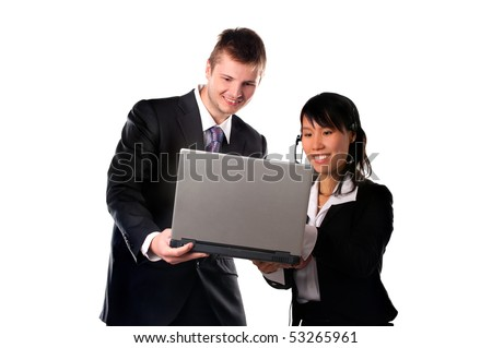 Happy businessman and businesswoman with laptop