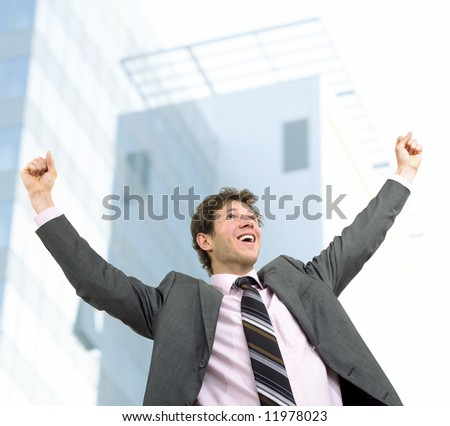 Happy businessman celebrating success, outdoor.