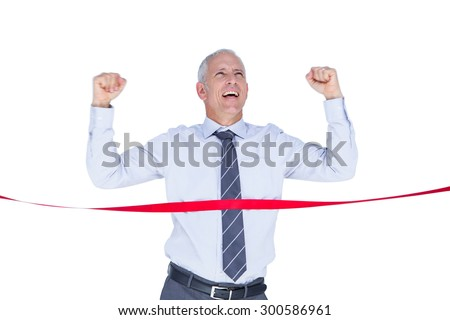 Happy businessman crossing red line on white background