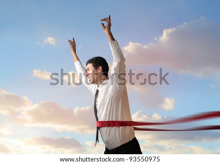 Happy businessman crossing the line - stock photo