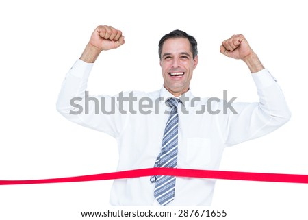 Happy businessman cutting red ribbonwith a blank background