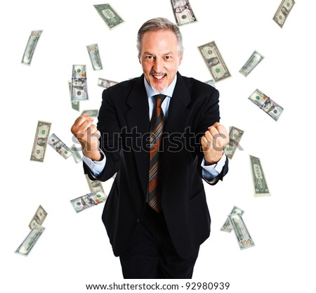 Happy businessman enjoying a rain of money