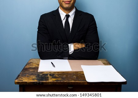 Happy businessman has just signed important deal