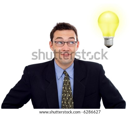 Happy businessman having a bright idea (represented by a yellow bulb)
