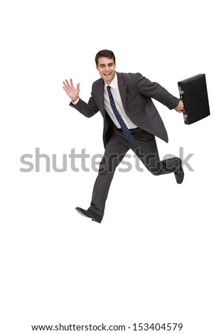 Happy businessman holding a briefcase and running on white background