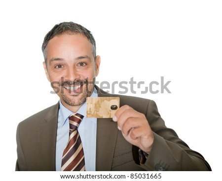 Happy businessman holding a credit crad - stock photo