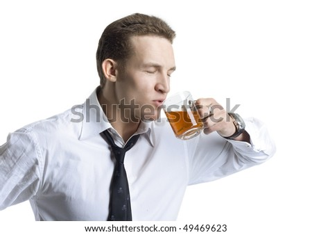 Happy businessman holding a cup of tea - stock photo