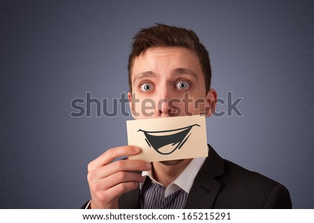 Happy businessman holding funny white card on his mouth with gradient background