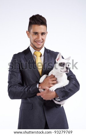 Happy businessman holding his puppy dog, a Boston Terrier - stock photo