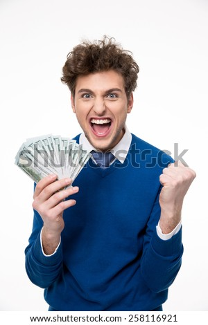 Happy businessman holding money over gray background - stock photo
