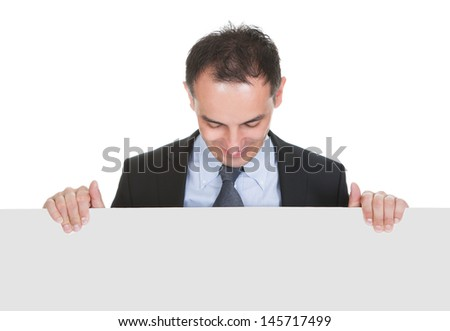 Happy Businessman Holding Placard Over White Background - stock photo