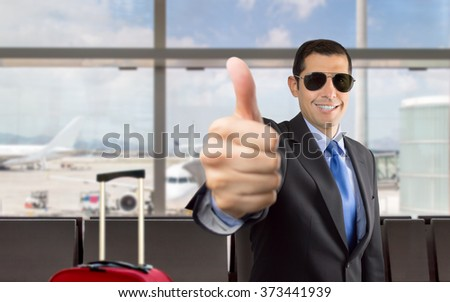 Happy businessman holiday travel at the airport - stock photo