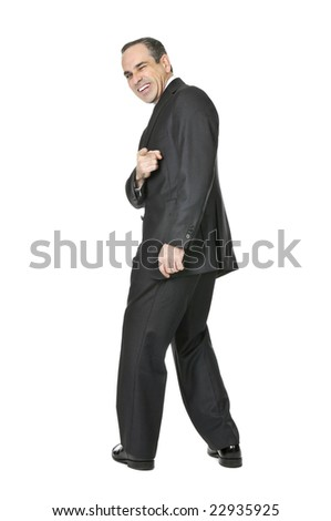 Happy businessman in a suit pointing at the viewer isolated on white background