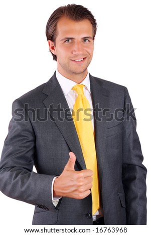 Happy businessman in a yellow tie showing thumb up - stock photo