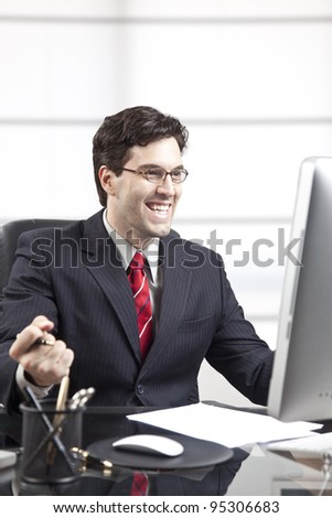 happy businessman in front of the computer. - stock photo