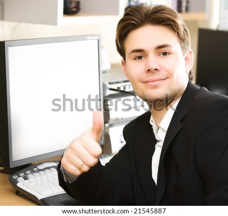 Happy businessman in office. Focus on face. - stock photo