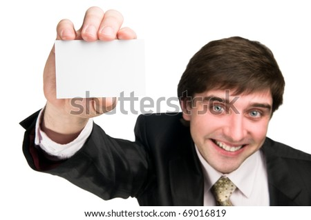 Happy businessman in suite showing business card in hand. Wide angle. Focus on hand