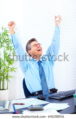 Happy businessman  in the office - stock photo