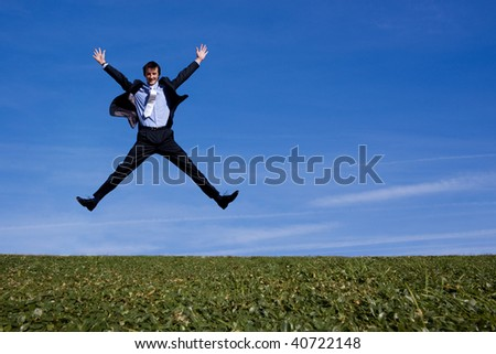 Happy businessman jumping for joy - stock photo