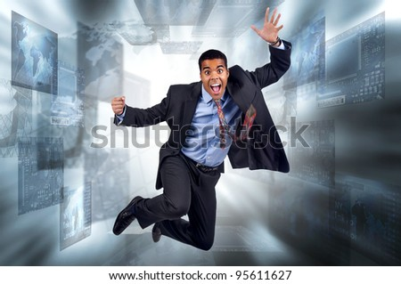 Happy businessman jumping in a digital screen background - stock photo