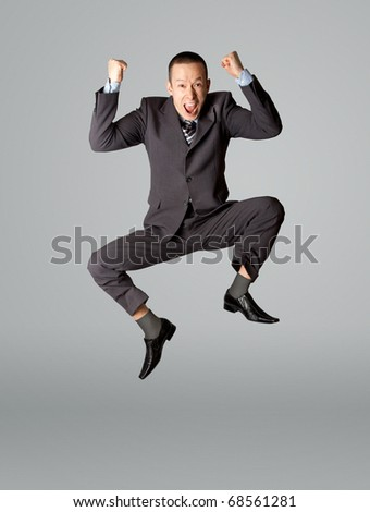 Happy businessman jumping in air isolated on white background - stock photo