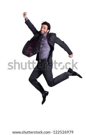 happy businessman jumping in the air in excitement, successful businessman jumping in the air against whit background - stock photo