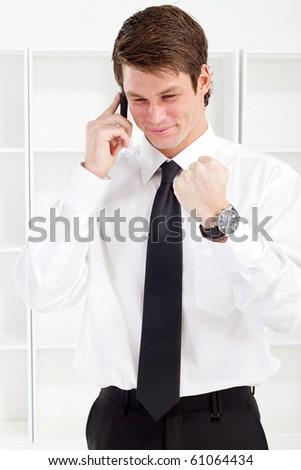 happy businessman on phone - stock photo