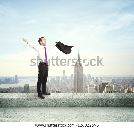 happy businessman on the roof