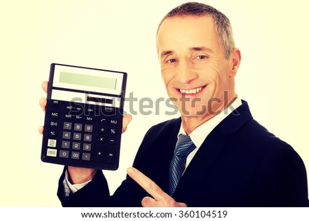 Happy businessman pointing on calculator