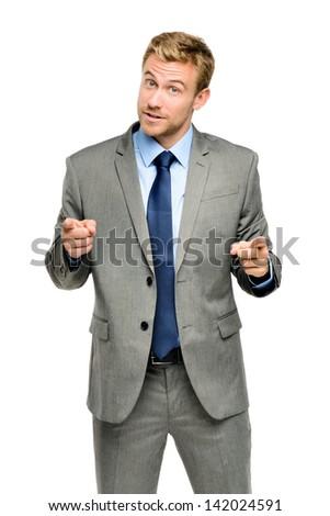Happy businessman pointing on white background - stock photo