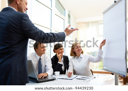 Happy businessman pointing out the aspects of the project - stock photo