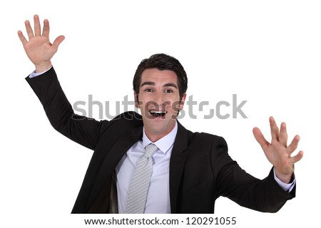 happy businessman raising hands - stock photo