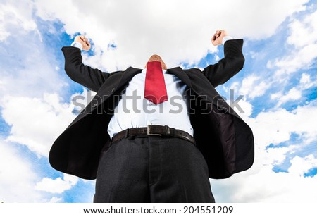 Happy businessman raising his arms - stock photo