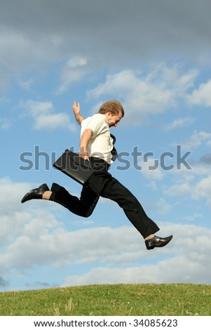 happy businessman running in the air - stock photo