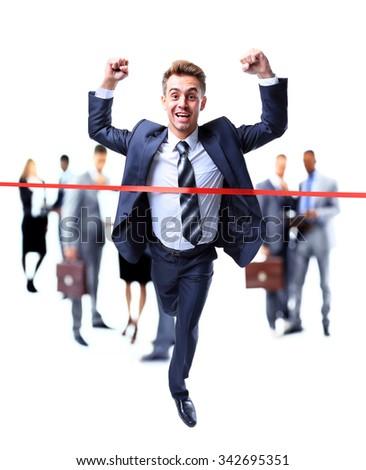 Happy businessman running through finishing line - stock photo