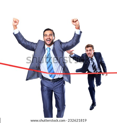 Happy businessman running through finishing line. Isolated on white - stock photo