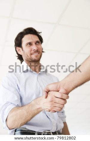 happy businessman shaking hands after an agreement - stock photo