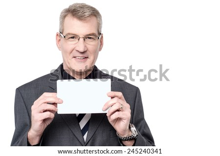 Happy businessman showing blank white card