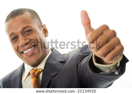Happy businessman showing his thumb up with smile over white background - stock photo