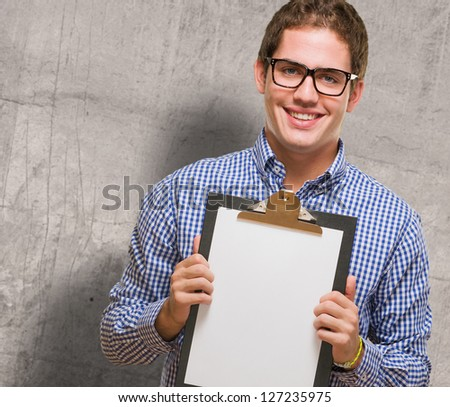 Happy Businessman Showing Paper On Clipboard against a grunge background - stock photo
