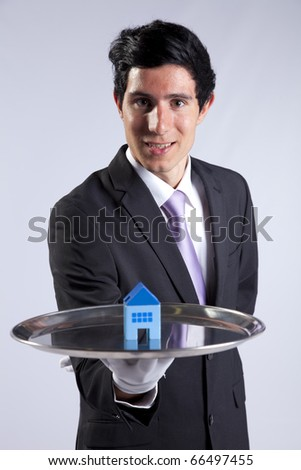 happy businessman showing you house services solutions - stock photo