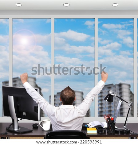happy businessman sitting in office and looking to window - stock photo