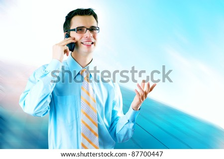 Happy Businessman standing on the business background - stock photo
