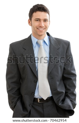 Happy businessman standing with hands in pocket, looking at camera, smiling. Isolated on white background.? - stock photo
