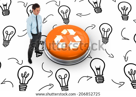 Happy businessman standing with hands in pockets against recycling symbol on white graphic background - stock photo