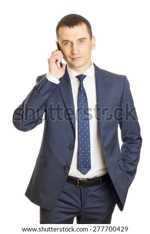 Happy businessman talking on his mobile phone