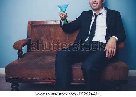 Happy businessman toasting - stock photo