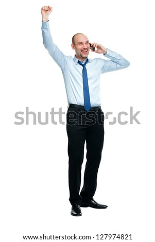 Happy businessman winning while talking on the phone - stock photo